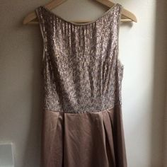 short gold sequin dress Sequin fit and flare dress. Worn once. Sequined bodice with frayed woven trim, silky woven skirt Exposed back zipper Pleated A-line skirt Fully lined 93% Polyester/7% Spandex The Limited Dresses