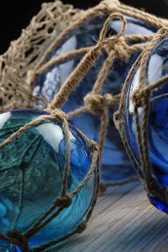 """Blue Nautical Glass Floats with Rope Lanyards ( Set of Three )$21  Small float is 4"""" wide  medium float is 5"""" wide  large float is 6-1/2"""" wide"""