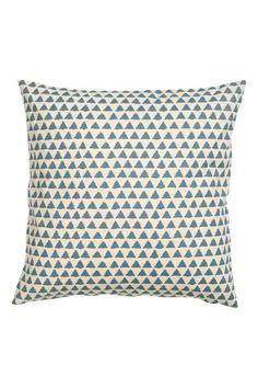 Vzorovaný povlak na polštářek: Povlak na polštářek z bavlněné tkaniny s tištěným vzorem. Skrytý zip.