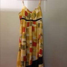 Simply Vera wang sundress Beautiful simply Vera wang sundress. Has an angled bottom & side pockets. It's a petite medium. I'm 5 feet tall & it came right above my shins. Simply Vera Vera Wang Dresses