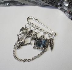 Hobbit bag charm. I would like these as stitch markers for crocheting!