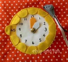 Telling time. Hickory the mouse and the flower clock quiet book page. The petals lift to reveal minutes.