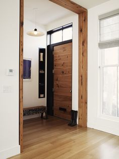 A common theme of the remodel was the incorporation of salvaged material, both from the original house and outside sources. Collaborating with Peter Buley of Analog Modern, the original hemlock fir joists of the house were repurposed into the main entry door. Adjacent to the door is a bench made from a heart pine beam, sourced by Buley. The beam had been charred during a circa-1900 fire, and subsequently painted over during the last 100 years. The unique piece now finds its home in the…
