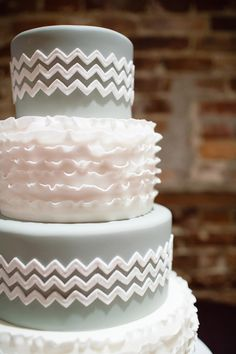 Chevron   A ruffled chevron cake combines masculine and feminine elements, the perfect marital compromise for a husband and wife.  Image via  Theo Milo .