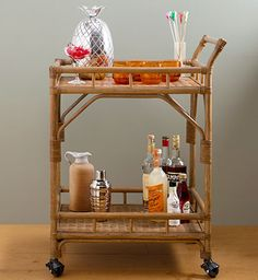 A tropical look might inspire you to stock this rattan bar cart tiki-bar-style—perfect for chasing away the cold. About $129 (available starting in January); Target