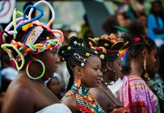 Girls present African-Colombian hairstyles during the 9th contest of Afro-hairdressers, in Cali, Valle del Cauca departament, Colombia, on May 12, 2013. The Afro hairstyles have their origins in the time of slavery, when women sat to comb their children hair after work. (Photo by Luis Robayo/AFP Photo) http://avaxnews.net/appealing/The_9th_Contest_of_Afro-hairdressers.html #avaxnews.net