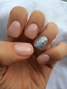 "OPI gel nail polish-"" bubble bath"" and a silver, glitter accent"