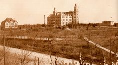 Above: The UT campus in the 1890s, as seen from the southwest at the corner of Guadalupe and 21st Streets. From left, the Chemistry Lab building, smokestack of the small power plant, two-thirds of the old Main Building, and B. Hall, the men's dorm. All were made from yellow pressed brick and limestone trim. The wooden fence along the perimeter kept out the local town cows.