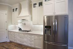 White kitchen, elegant kitchen, subway tile, shaker cabinets, quartz countertop, wood tile.  McKinney Homes Custom Home.