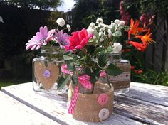 Burlap and button decorated glass jars