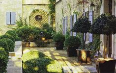 best of french country...gorgeous garden courtyard for a small space!