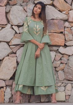 Best 12 Readymade Cotton Pakistani Suit in Dusty Green This Round Neck and Quarter Sleeve attire with Cotton Lining is Prettified with Block and Golden Print Available with a Dusty Green Cotton Plazzo and a Dusty Green Cotton Dupatta The Kameez and Bottom Pakistani Designer Suits, Pakistani Dress Design, Pakistani Outfits, Indian Designer Wear, Kurti Designs Pakistani, Pakistani Gowns, Pakistani Party Wear Dresses, Dress Indian Style, Indian Fashion Dresses