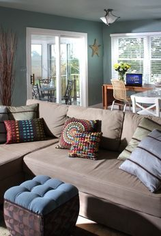 This wall color is similar to my foyer (Valspar Patina Blue), and I like the color of the sofa as a complementary color to use in the family room.