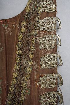 Detail of Corset, 18th century, American or European, silk, metal, check out the silver fasteners - upside down deer (?) with antlers and leaf work!