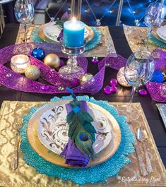 Peacock Tablescape What a beautiful table setting with peacock colors! I love the gold and teal place setting and the purple napkins. It would be perfect table decor for a birthday party or wedding. Click through to find more great table decorating ideas. Birthday Party Table Decorations, Birthday Party Tables, Christmas Party Decorations, Decoration Table, Parties Decorations, Christmas Tablescapes, Christmas Candles, Holiday Tables, Christmas Stuff