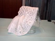 Beveren cap lace, a point ground lace