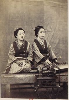 Two women with a Koto (musical instrument) - Social life and customs in Nagasaki. Japan. 1870. S)