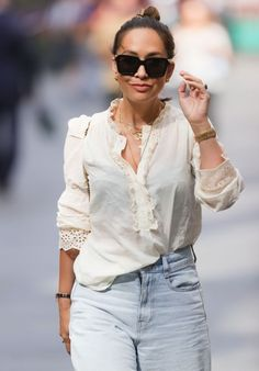 Myleene Klass in White Blouse and Flared Denim | For more style inspiration visit 40plusstyle.com