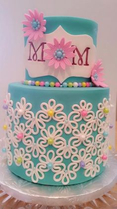 This double decker Mother's Day cake is a beautiful backdrop for a spring brunch. This Craftsy member uses piping, flowers, and vibrant color for an eye-stopping design.
