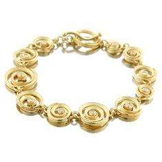 """Barbara Heinrich Bracelet Swirl bracelet in 18k yellow gold, set with .89 cttw diamonds and wavy toggle clasp. 7.5"""" Long."""