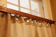 Yardstick with hooks attached - cute idea for sewing/craft room