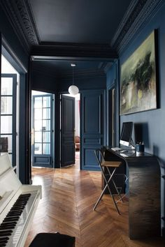 Navy blue walls, herringbone floors