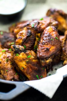 Tandoori Crispy Baked Chicken Wings - Marinated in Greek yogurt and baked, not fried, these super easy chicken wings.with a little Indian spice, are a healthier crowd pleaser! Tandori Chicken, Grilled Tandoori Chicken, Crispy Baked Chicken Wings, Healthy Chicken, Healthy Appetizers, Appetizer Recipes, Indian Food Recipes, Ethnic Recipes, Chicken Wing Recipes