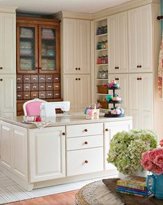 GORGEOUS!  Whenever I am ready to upgrade my room, I want nicer countertops and I love the skinny cabinets that I would bet hold fat quarters and notions!