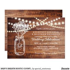 BABY'S BREATH RUSTIC COUNTRY | MASON JAR WEDDING CARD RUSTIC COUNTRY MASON JAR WEDDING INVITATION | Wooden background with string of lights, mason jar containing baby's breath flowers and your wedding wording in white.