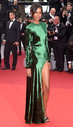 LIYA KEBEDE wears a shimmering emerald column with long sleeves and a high slit to the Unknown Girl premiere.