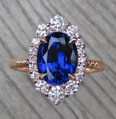 Vintage-Inspired Oval Blue Sapphire and Diamond Halo Engagement Ring in Rose Gold Classic Engagement Rings, Platinum Engagement Rings, Wedding Engagement, Blue Wedding Rings, Wedding Jewelry, Halo Diamond, Halo 3, Or Rose, Rose Gold