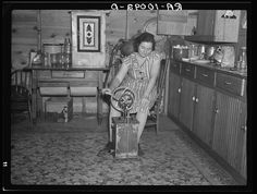Farmer's wife churning butter. Emmet County, Iowa, circa 1936