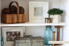 How to give a white entertainment center character with vintage finds and family memorabilia | www.meadowlakeroad.com