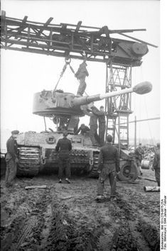 Repairing a Tiger I heavy tank in a field workshop, Russia, Jan-Feb 1944. Aside from the heavy lift crane necessary to handle pieces weighing several tons each, these workshops required extensive tool inventories, not to mention machine tools capable of machining individual parts not available as spares.