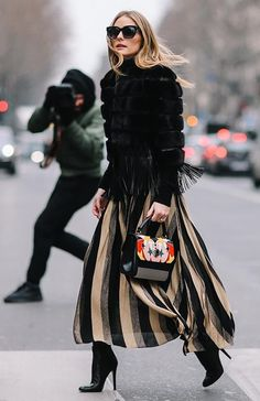 Olivia Palermo + edgy street style + striped maxi skirt with fur jacket + fall outfit inspiration