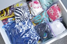 bathing suits in plastic baggies… a great way to keep your bikinis together and organized.  This makes for easy storage in the winter too!