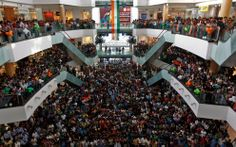 Cricket fans watch the Cricket World Cup final match between India and Sri Lanka, on a big screen inside a shopping mall in Kolkata April 2, 2011. (Reuters/Rupak De Chowdhuri)