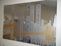 This is a fantastic 4-piece etched mirror set showing part of the New York City skyline. Description from instappraisal.com. I searched for this on bing.com/images
