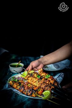 Learn to make Restaurant style Tandoori Paneer Tikka recipe with video instructions in 4 ways using oven, pan, grill and panini maker. A perfect appetizer.