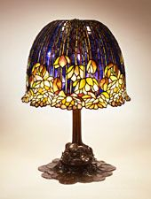 Pond Lily Library Lamp 1900-1910    Tiffany Studios, New York  Leaded glass, bronze  Total height: 23.0 in. (58.42 cm);  diameter: 20.5 in. (52.07 cm)  Electric lamp, No. 344, Pond Lily lamp and shade, large  Not marked  N.86.IL.18ab