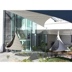 Hanging chair or hammock - Songo Earth and Songo Moon in a contemporary garden
