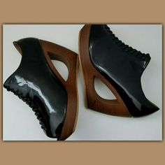 PARTY SALE REG  ?HP? Unique Wedges Black patent leather, make a statement in these unique heels.  Heel is brown 4 1/2 Inch heel Shoes Wedges