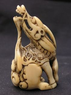 Kirin. Fabulous ivory netsuke of a Kirin signed Mitsuharu. Very high quality carver mentioned in the Soken Kisho. Kyoto school pre 1781. This fine example with good patina has some nice wear.