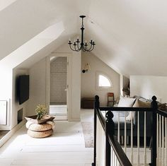 Attic renovation inspo. Behr Deck Over in matte white.