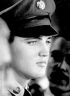 Elvis photographed by Bill Ray during a press conference at the Brooklyn Army Terminal, September 22, 1958