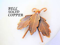 """This copper bee bug pin is signed """"Bell Solid Copper. Stamped with a design in the copper, this"""