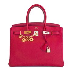 Hermes Rouge Casaque Lipstick Red 35cm Birkin Gold GHW Tote Satchel Bag - Store fresh.  Pristine condition.  T stamp. Perfect gift!  Coming full set with keys, lock, clochette, a sleeper for the bag, rain protector, and signature orange Hermes box. Rouge Casaque is a gorgeous true lipstick red. In a firm and scratch resistant Clemence leather.  Completely stunning lipstick red in combination with luxurious gold hardware. This Birkin is first class all the way. Very hard to find combin...