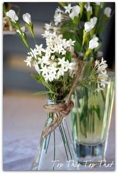 flower arrangement idea - use twine/rope tied around glass vase for a rustic | http://flowerarrangementideas.blogspot.com