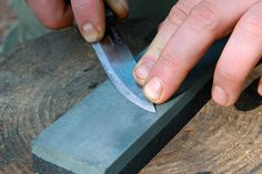 Lift the handle to maintain contact with the stone towards the tip of the knife. Photo: Ben Gray.