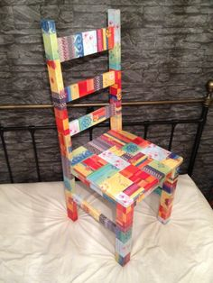Decoupage Patchwork Chair MY NOTES: Do this for N's room using shades of blue and black, and astronomy patterned paper